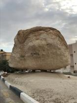 A big rock on top of little rocks