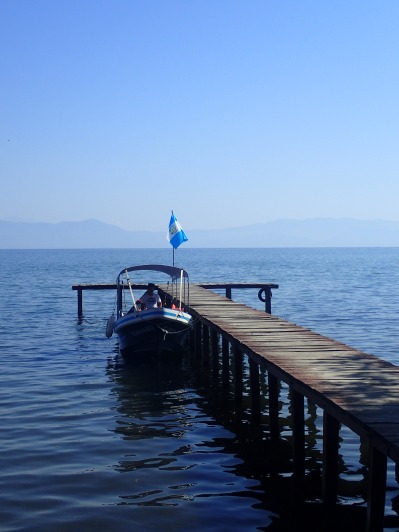 A boat, a jetty and a flag
